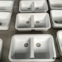 White solid surface small double kitchen sink