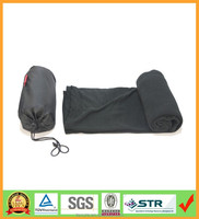 Black airline travel throw blanket with a nylon drawstring pouch