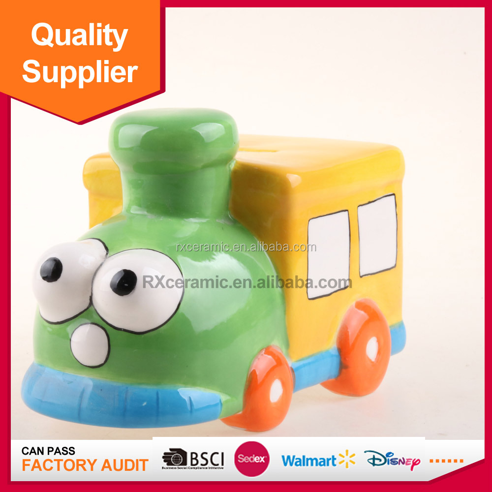 Hot selling train shape piggy bank ceramic coin bank with handle