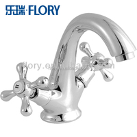 classic design brass double handle basin taps used in kitchen