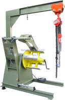 hydraulic rewinder with hold down arms crane