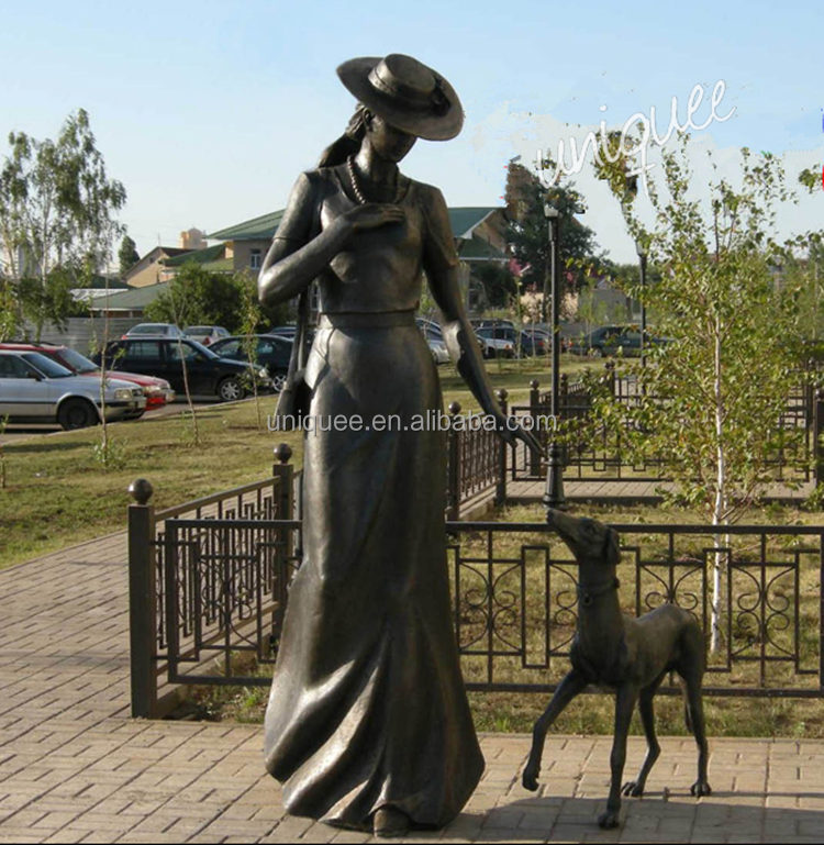 large garden art metal sculptures of lady and dog