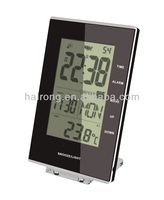 Radio controlled digital clock with snooze function
