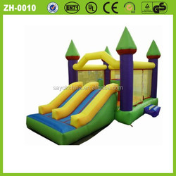 bouncer with slide inflatable green slide