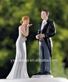 Bride Blowing Kisses and Traditional Groom Wedding Cake Topper
