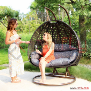Foshan Hot Patio Egg Chair Rattan Garden Wicker Outdoor Furniture Luxury Double Seater Hanging Swing Chair with Cushion Hammock