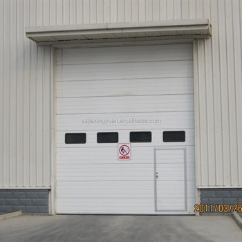 Industrial door with walker door with windows