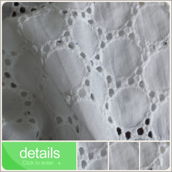 white eyelet embroidery on cotton voile fabric