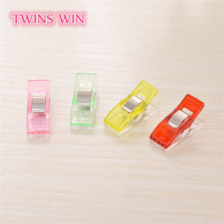 Best sale in America daily used items white and red spring clip 100 pcs wholesale plastic clip