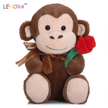 Factory custom-made sitting position monkey plush toy custom stuffed monkey with flower baby doll valentine gift new wholesale