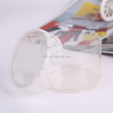 Cylinder shaped clear PVC plastic boxes with slip over lids sized to hold gumballs