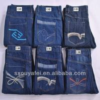 stock garment lot for mens demin jeans with Embroidered pockets stock apparel cancelled order mens jeans pants