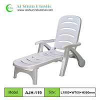 White plastic folding beach lounge chair with wheels