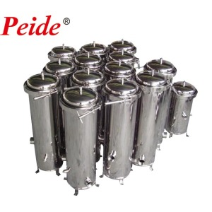 Cartridge filter housings for drinking water