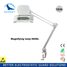 Adjustable magnifying glass LED lamp for reading and beauty equipment working illuminated