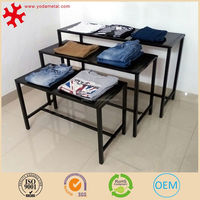 Modern 3-layer retail store fixture metal clothing display table with 4 legs