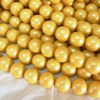 yellow color synthetic Pearls