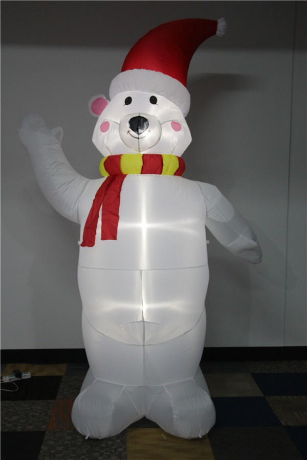 Standing Inflatable white bear wearing a scarf and red hat 2017