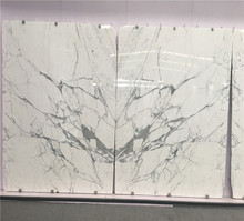 book matched Statuario marble slabs for bathroom