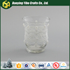 Clear glass candle holder with white lace decoration