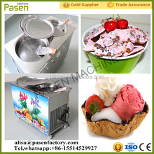 Two pans stirring ice cream machine