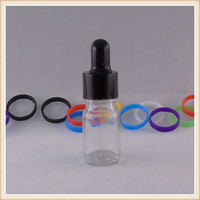 small clear empty liquid glass essential oil bottle with eye dropper