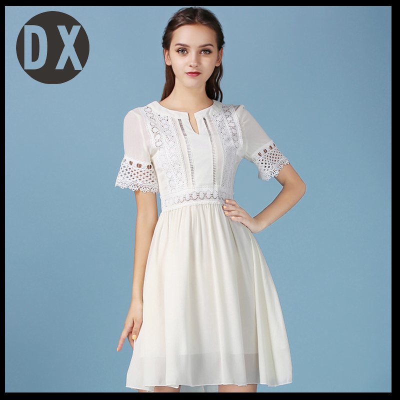 New spring and summer white lace dress female chiffon dress cents Korean short - sleeved round neck collar hollow dress