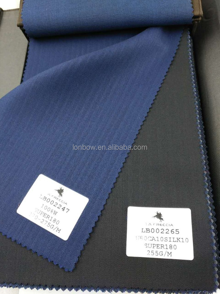 High quality royal blue herringbone wool material super 180 suiting fabric for stock service