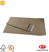 natural brown kraft paper mail envelop with adhesive tape