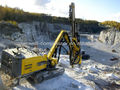 Atlas Copco Drill rigs and rock drills (AC Drill rigs and rock drills ) FlexiROC T40 : Tophammer drill rig