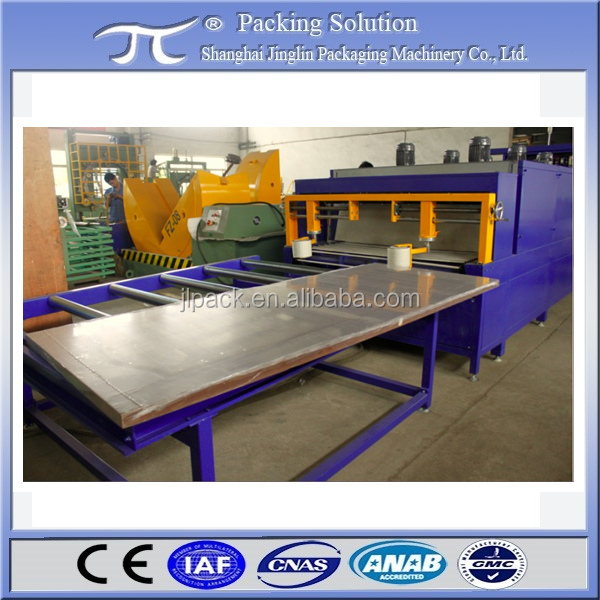 Automatic wood door sealing and shrinking packing machine