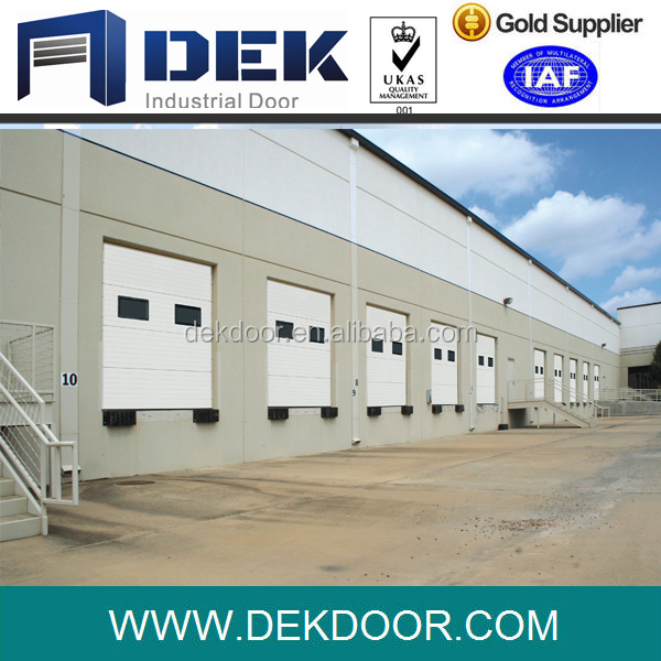 Insulated Sectional Door coloured White including Service Door