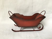 Antique red metal Christmas sleigh for holiday decoration