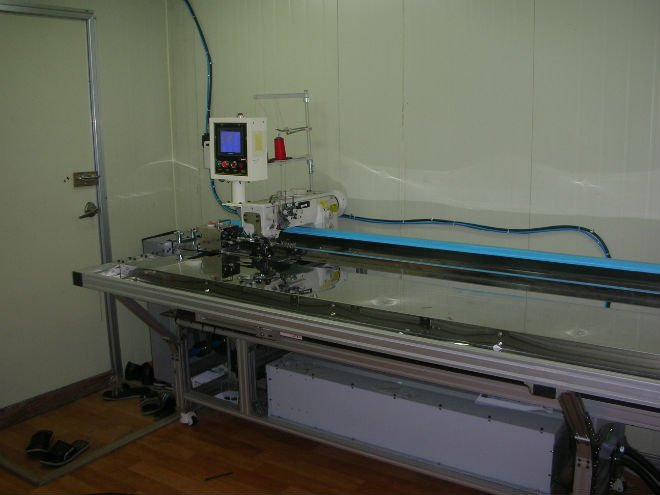 Automatic sewing machine for awning