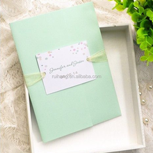 Elegant mint green pocker fold wedding invitations with colorful dot & yellow ribbons