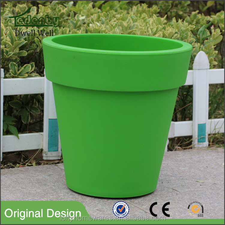 Round colorful plastic flower pot with wheels