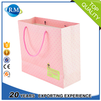 Popular branded customized shopping paper bag with handles