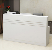 Customized color FR-MDF PD material modern wooden hotel reception counter design