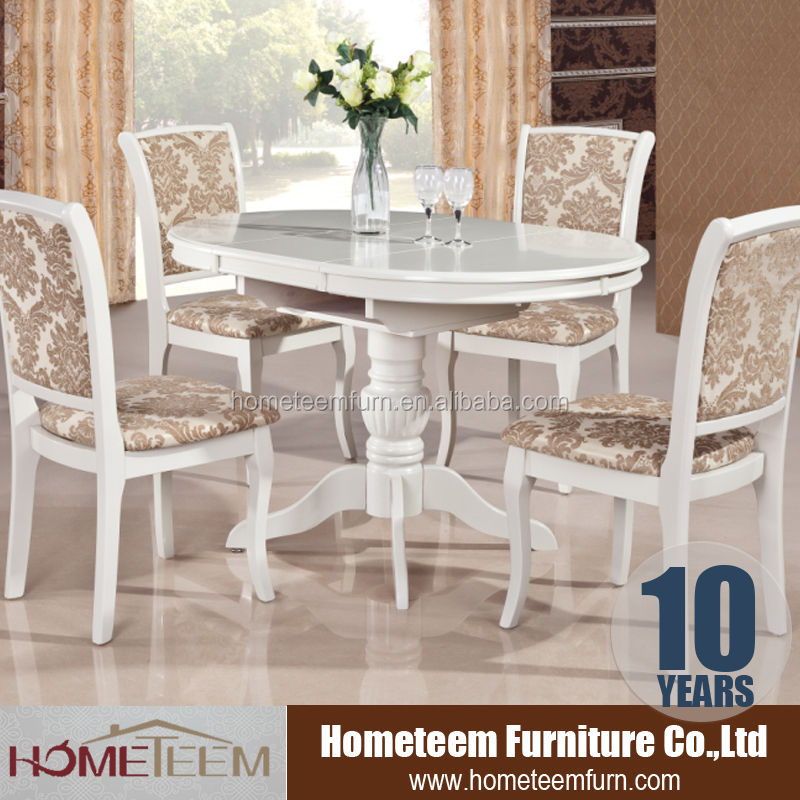 cream colored dining room table and chairs set