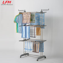 Top stainless steel rotating clothes hanger rack