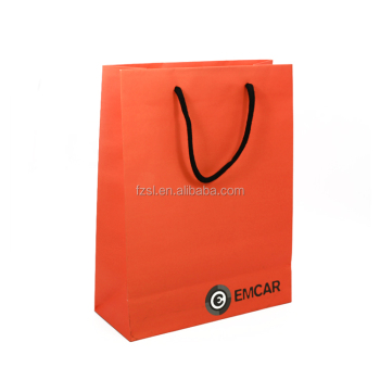 Orange kraft paper bag with cotton cord handle