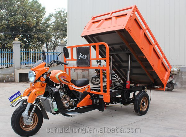 Motorized freight tricycle for cargo transportation with a hydraulic self dumping bed