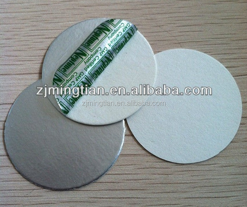 High resistance foil liner composite paperboard for bottle cap sealing