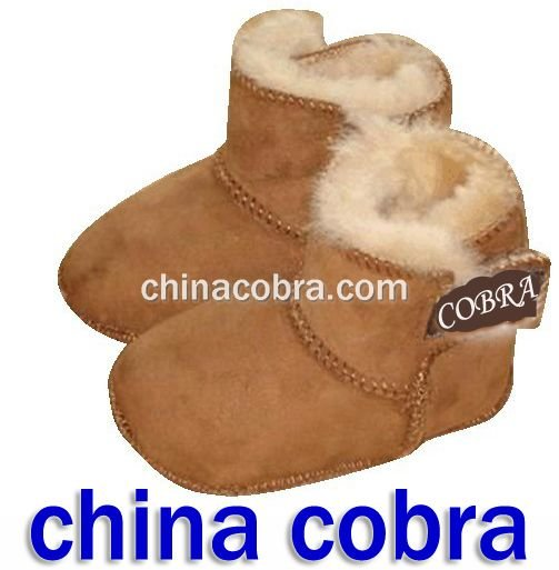 china cobra soft sole leather baby booties (newest popular design)