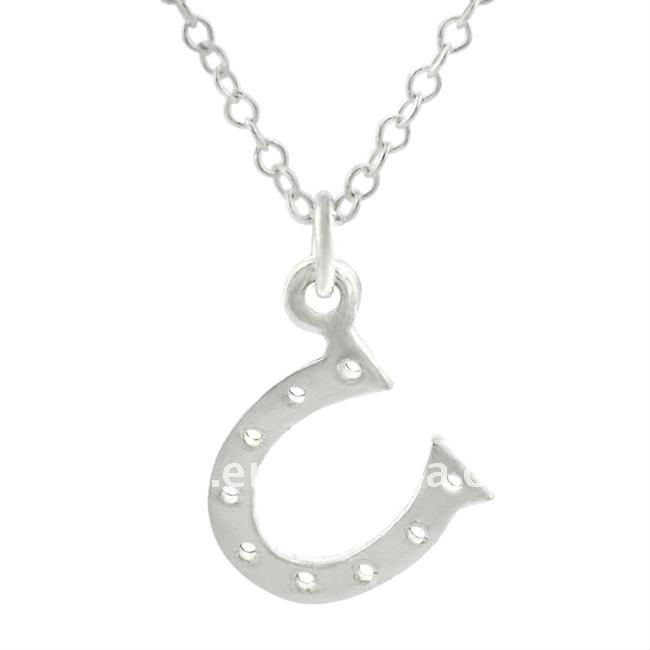 a silver horseshoe design and a highly polished pedant necklaces jewelry