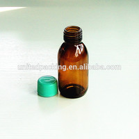 100ml amber glass bottle with fancy caps