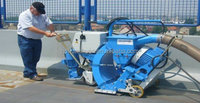 Portable surface shot blasting machine is used to clean up the concrete pavement