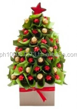 Xmas tree and bouquet with chocolates