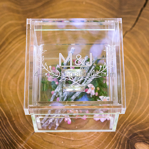 Clear acrylic wedding ring box with floral accents beneath rings custom