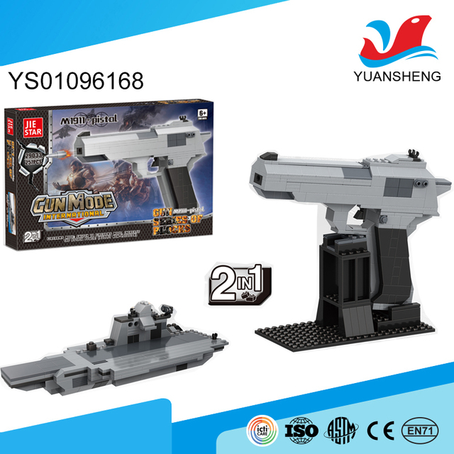 kids play building blocks assembled gun model funny different kinds of toys for learning